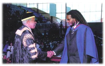 Tacuma Seen Here Accepting His Degree