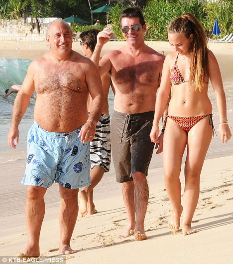 "Skipping out on the whole notion of having a ""white Christmas,"" Simon Cowell was spotted frolicking around the beach in Barbados yesterday (December 25).  The snide ""American Idol"" judge looked to be having a marvelous time in paradise, hanging out with British billionaire Philip Green as well as spending some time on a wave runner."