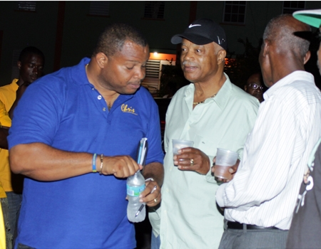 Embattled Leroy Parris flanked by Chis Sinckler, minister of finance and Hal Gollop QC, Parris' lawyer on the campaign trail in 2013