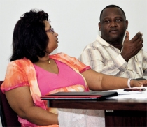 Chief Medical Officer Joy St. John (l) Donville Inniss former minister of health