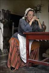 Always exploited, often brutalized, indentured servants were slaves without shackles. Liz Wiley, here, finds a moment of rest. Photo by Dave Doody - http://www.history.org/