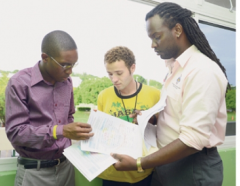 (L-R) Guild President; Damani Parris, Law Rep; Daniel Davies, Guild Treasurer; Ital Spencer reviewing a student petition against paying tuition fees