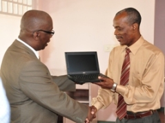 Minister of Education Ronald Jones (l) Dr. Gladstone Best, Principal of the BCC