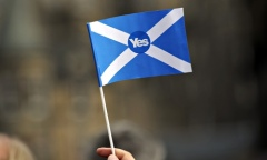 supporter of Scottish independence holds a yes flag. Photograph: Andy Buchanan/AFP/Getty Images