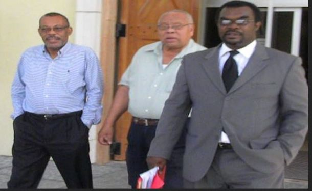 From left, fraud accused Rodney Wilkinson, accompanied by businessman Lionel Riley and attorney Marlon Gordon,