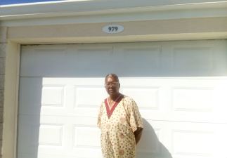 Monica Boyce outside her home at 979 Tamarind Drive, Villages at Coverley