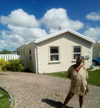 Monica showing her home at 979 Tamarind Drive, Villages at Coverley