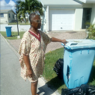 Monica showing her damaged garbage bin