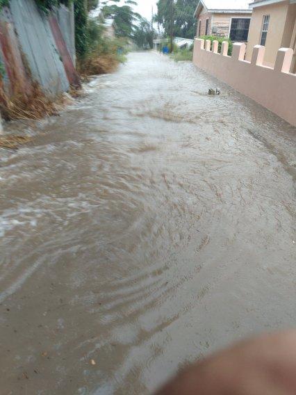Water flowing in Claarke's Road
